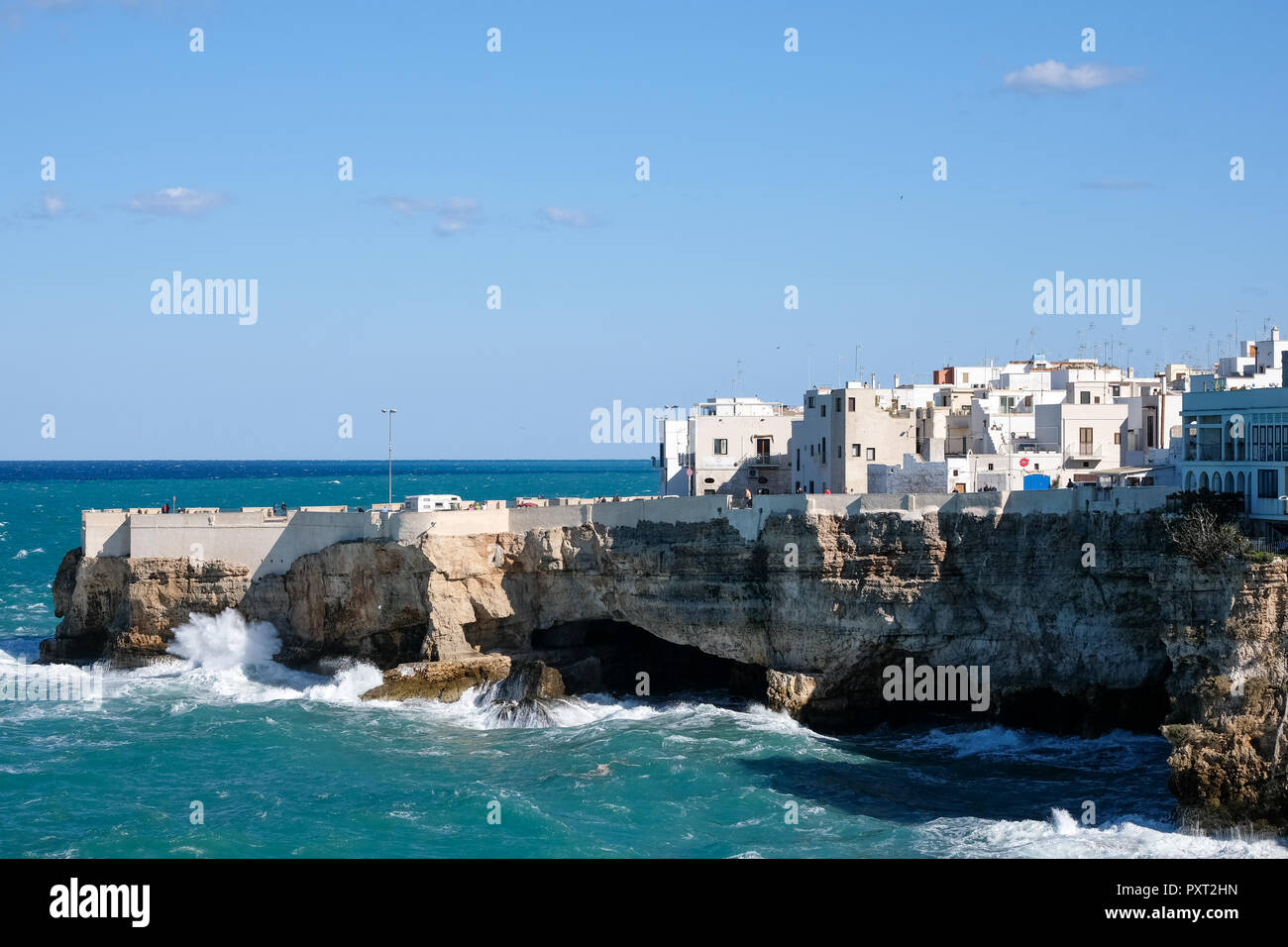 Polignano a Mare, Italy. View of the cliffs and sea at the coastal town of Polignano a Mare in Puglia, Southern Italy. Photographed on a sunny day. - Stock Image