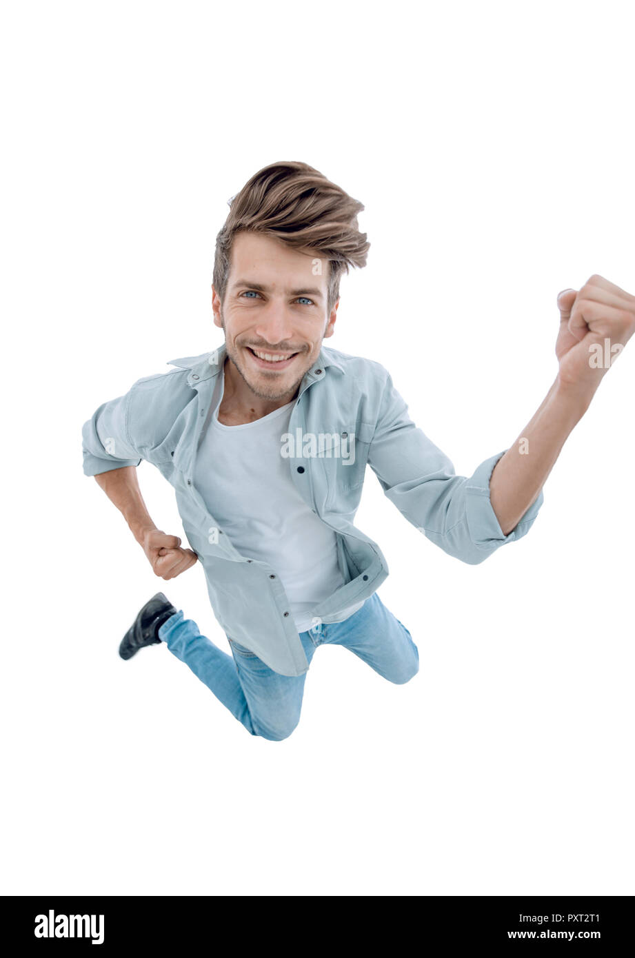 the man in jeans jumped like a superman. man in studio - Stock Image
