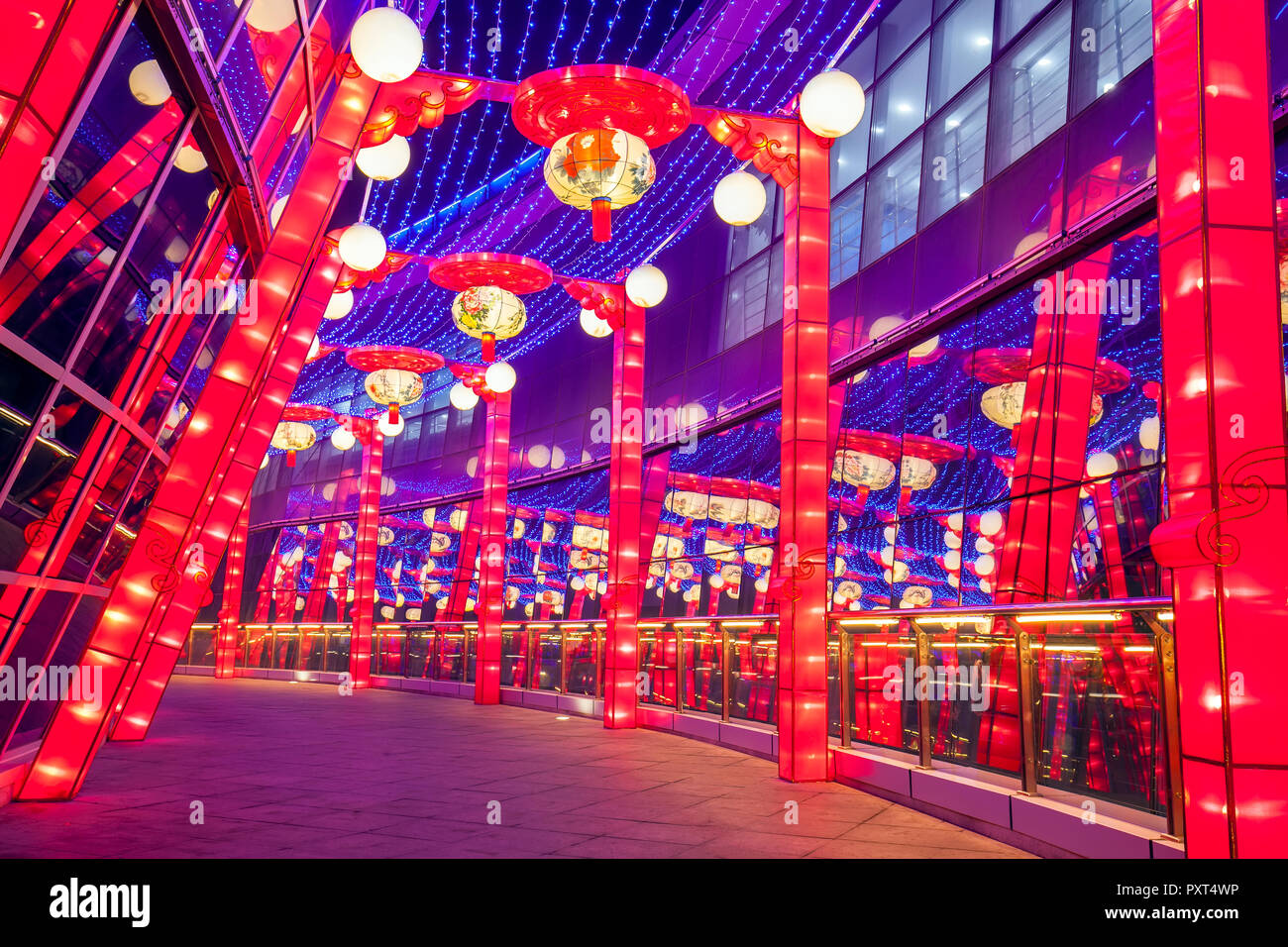 Modern architecture glass curtain wall and Chinese lanterns Stock Photo