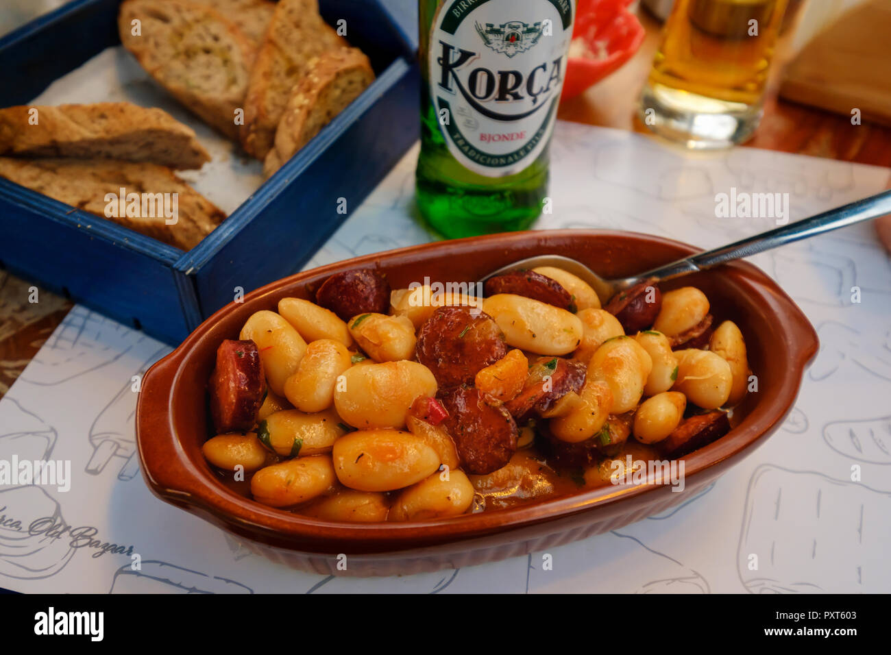 Typical dish, bean stew with sausage, Tave e shtëpisë, Albanian beer, Korca, Albania Stock Photo