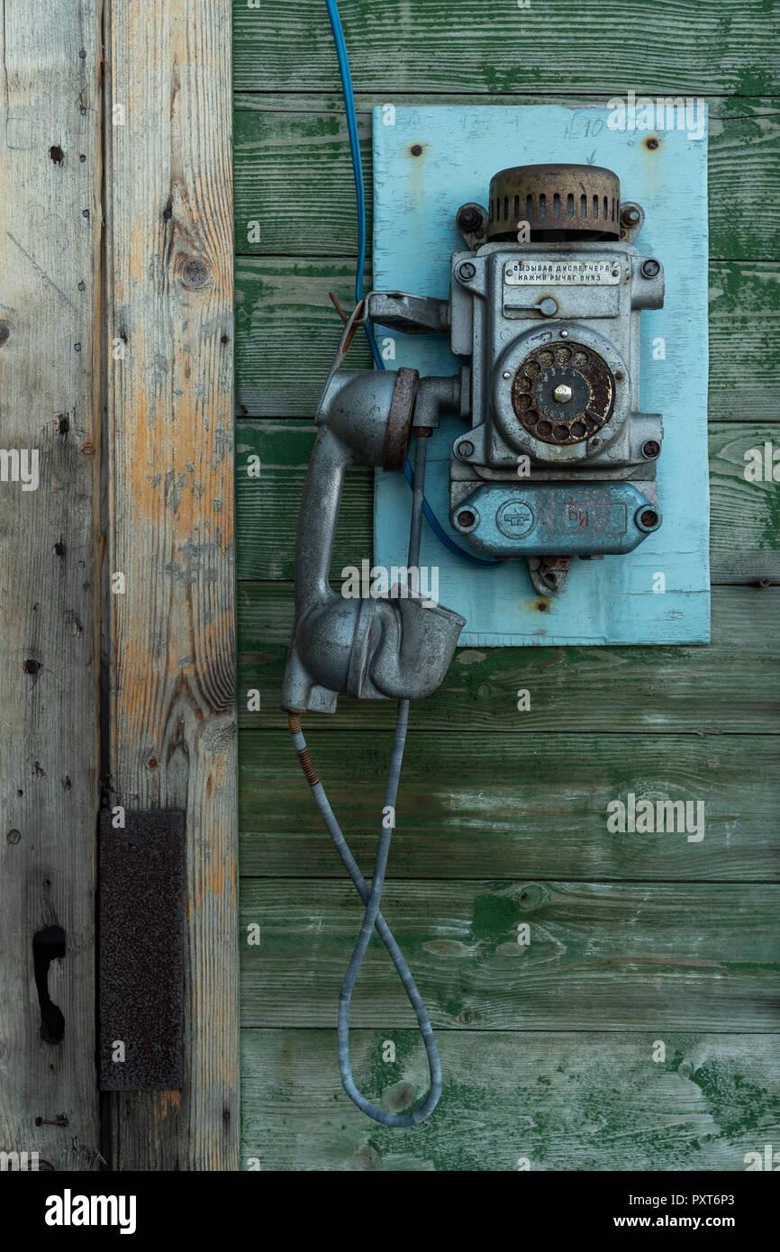 Old wall telephone, Russian miners' settlement Barentsburg, Isfjorden, Spitsbergen, Svalbard, Norway - Stock Image