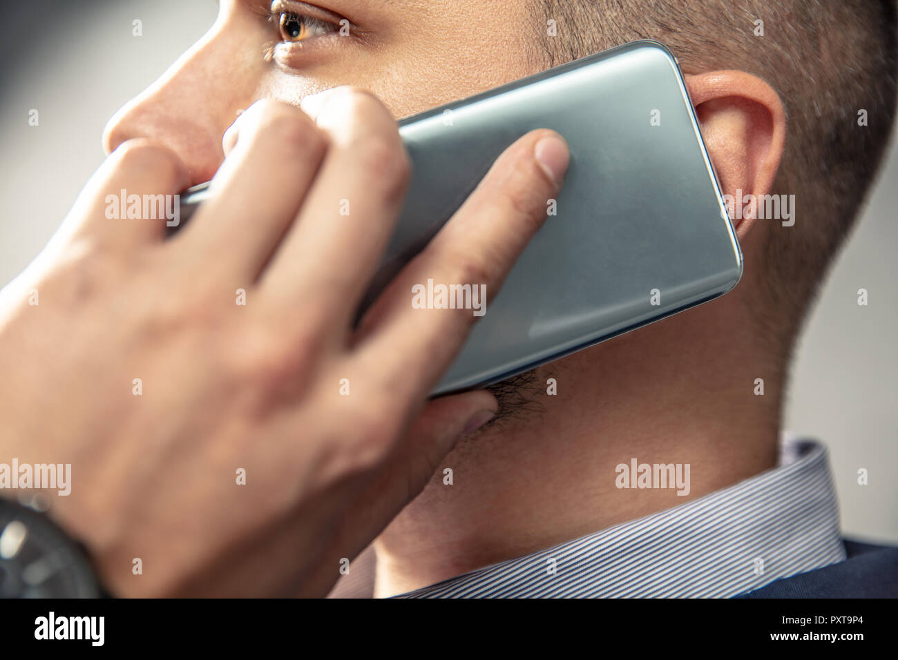 Elegant man is talking on the phone. Horizontal orientation of photo - Stock Image
