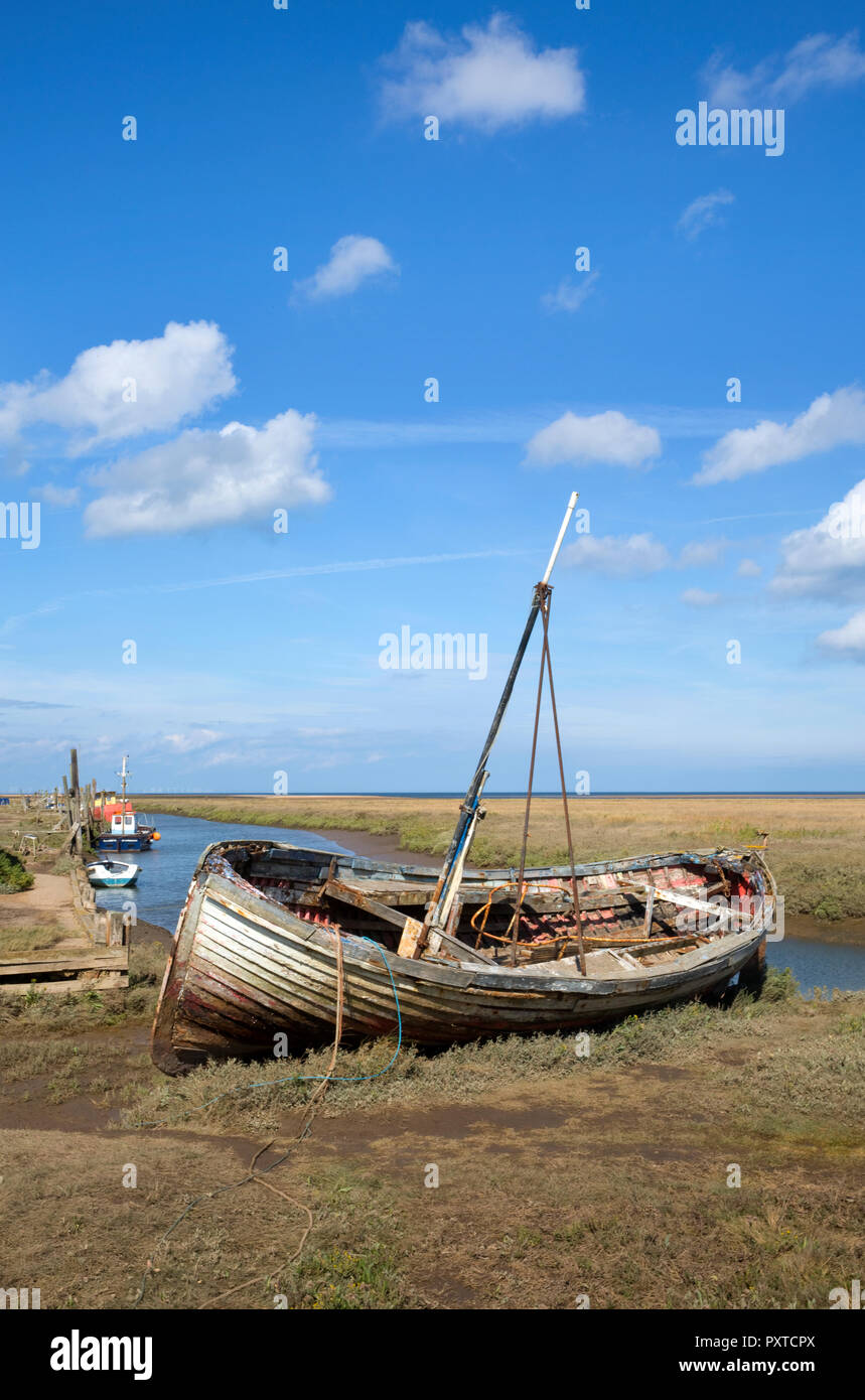 Boats on estuary at Thornham Old Harbour, Thornham, Norfolk, England - Stock Image