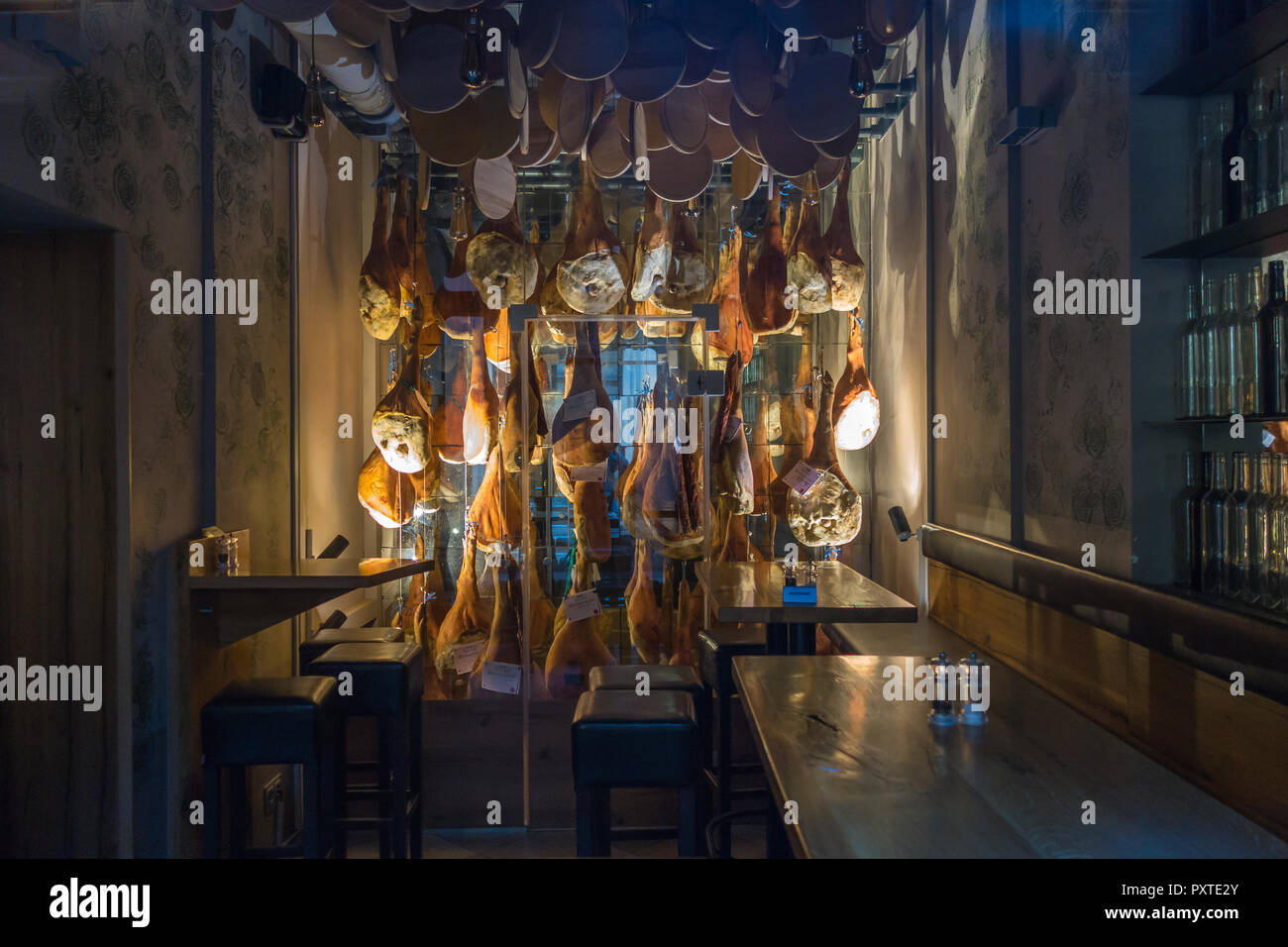 Vienna, Austria - Februay 5, 2017: A small intimate restaurant displays its certified meats in a glass fridge next to guest tables - Stock Image
