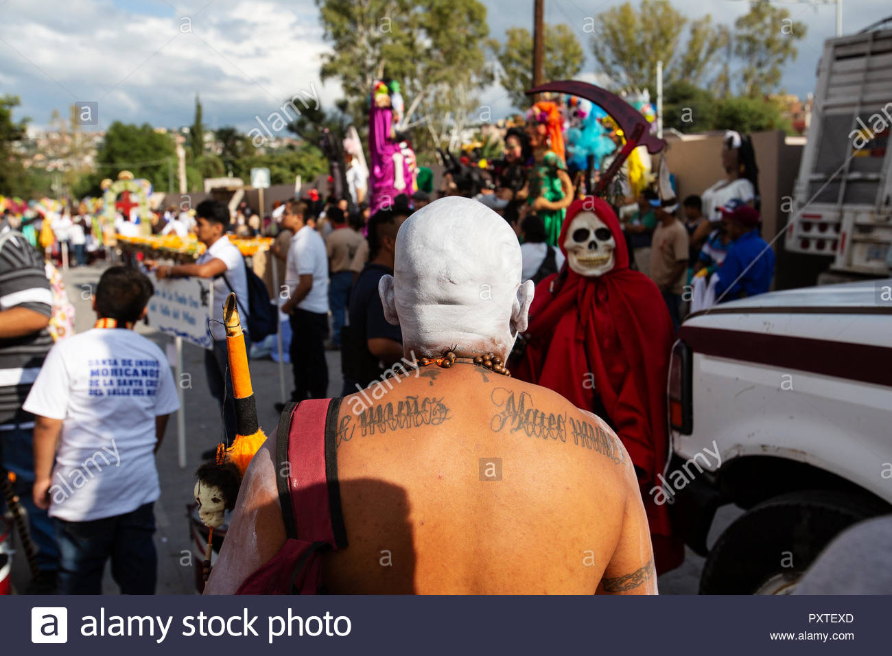 A bald headed celebrant with his head painted white at the annual Sep festival of San Miguel de Allende where local people dress up in costumes and dance in parades. - Stock Image