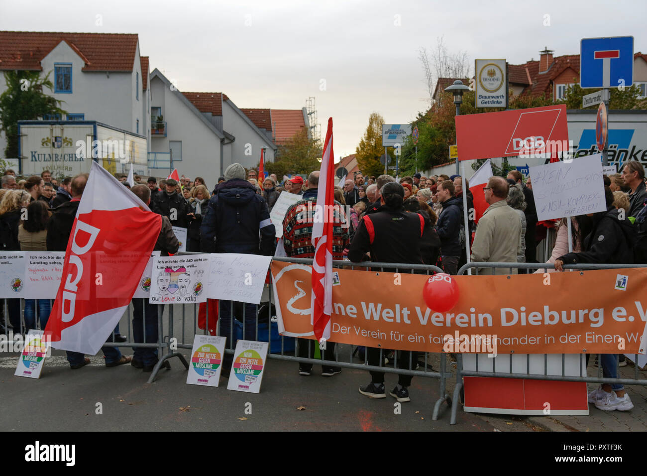 Dieburg, Germany. 23rd Oct, 2018. Some counter protester stand outside the venue. German Chancellor Angela Merkel attended a political rally of her CDU party in Dieburg ahead of the upcoming state election in the German state of Hesse. With less than a week to go to the election, the CDU is still leading the polls, but gas lost more than 10% compared to the last election. Credit: Michael Debets/Pacific Press/Alamy Live News - Stock Image