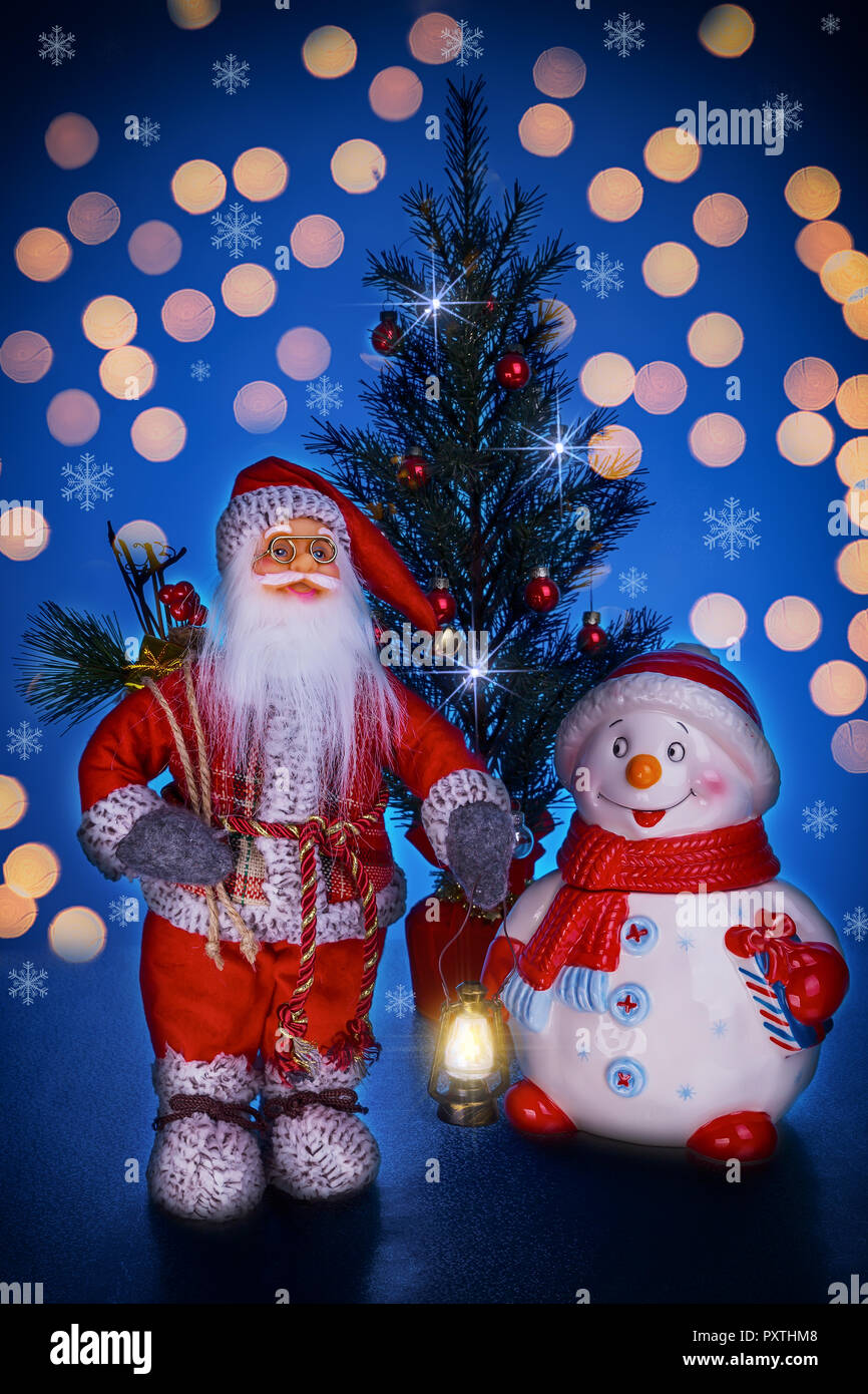 Santa Claus Snowman And Christmas Tree On A Dark Blue Background