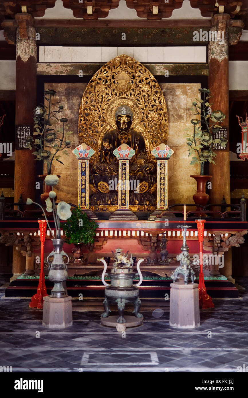 Beautiful ancient golden Buddha statue in Butsuden, Buddha Hall, of Daitoku-ji, Japanese Zen Buddhist temple, Kyoto, Japan - Stock Image
