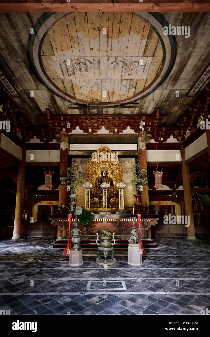 Beautiful ancient golden Buddha statue in Butsu-den, Buddha Hall, of Daitoku-ji, Zen Buddhist temple, Temple of Great Virtue, Kyoto, Japan - Stock Image