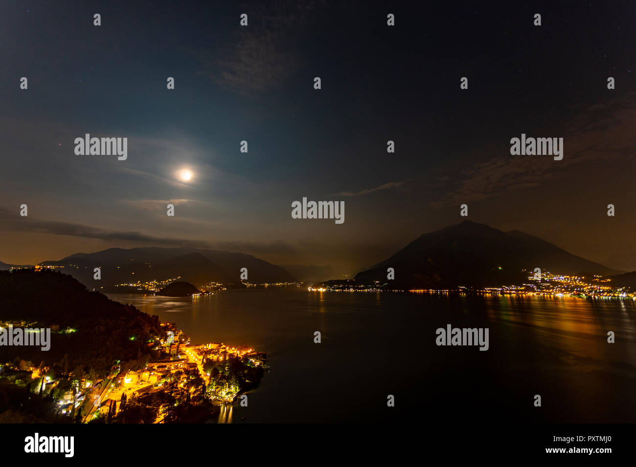 Moon over Lake Como in the Italian mountains at nightStock Photo