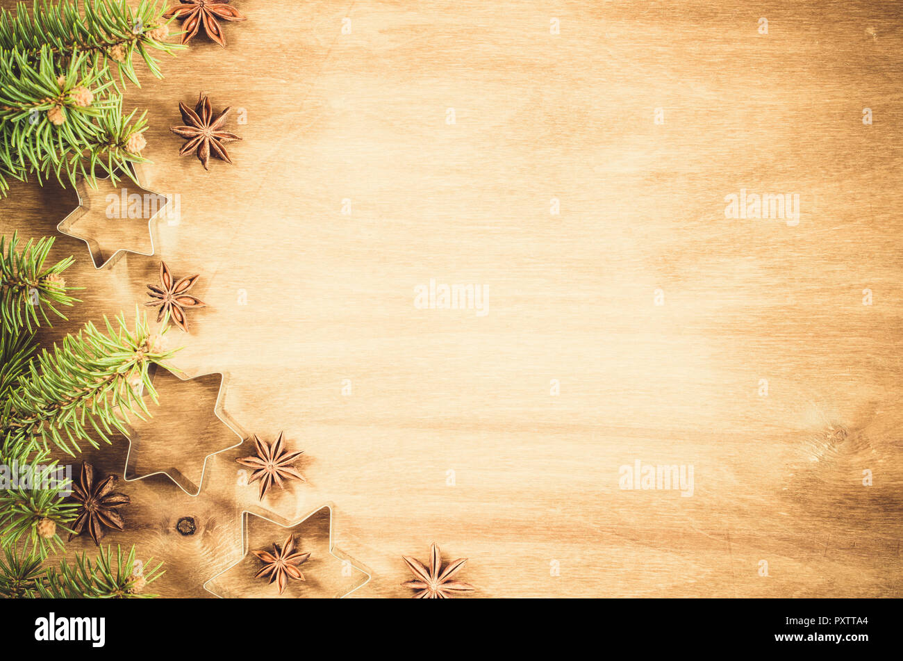 empty paper for recipe of christmas baking culinary background stars anise and cutters for christmas cookie branch of christmas tree top view cop
