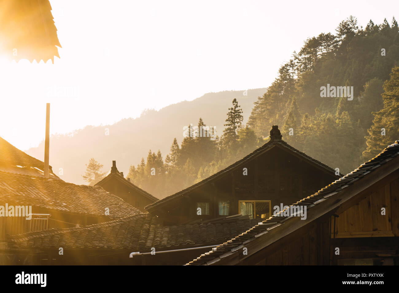 China, Guizhou, houses of a Miao settlement in backlight Stock Photo