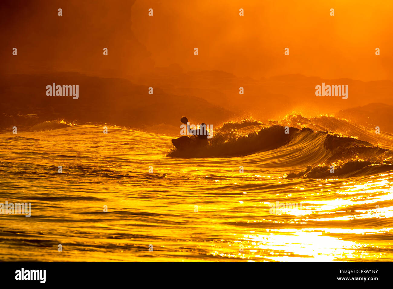 UK, Scotland, East Lothian, Water Sport, Kayak Surfing, sunset - Stock Image