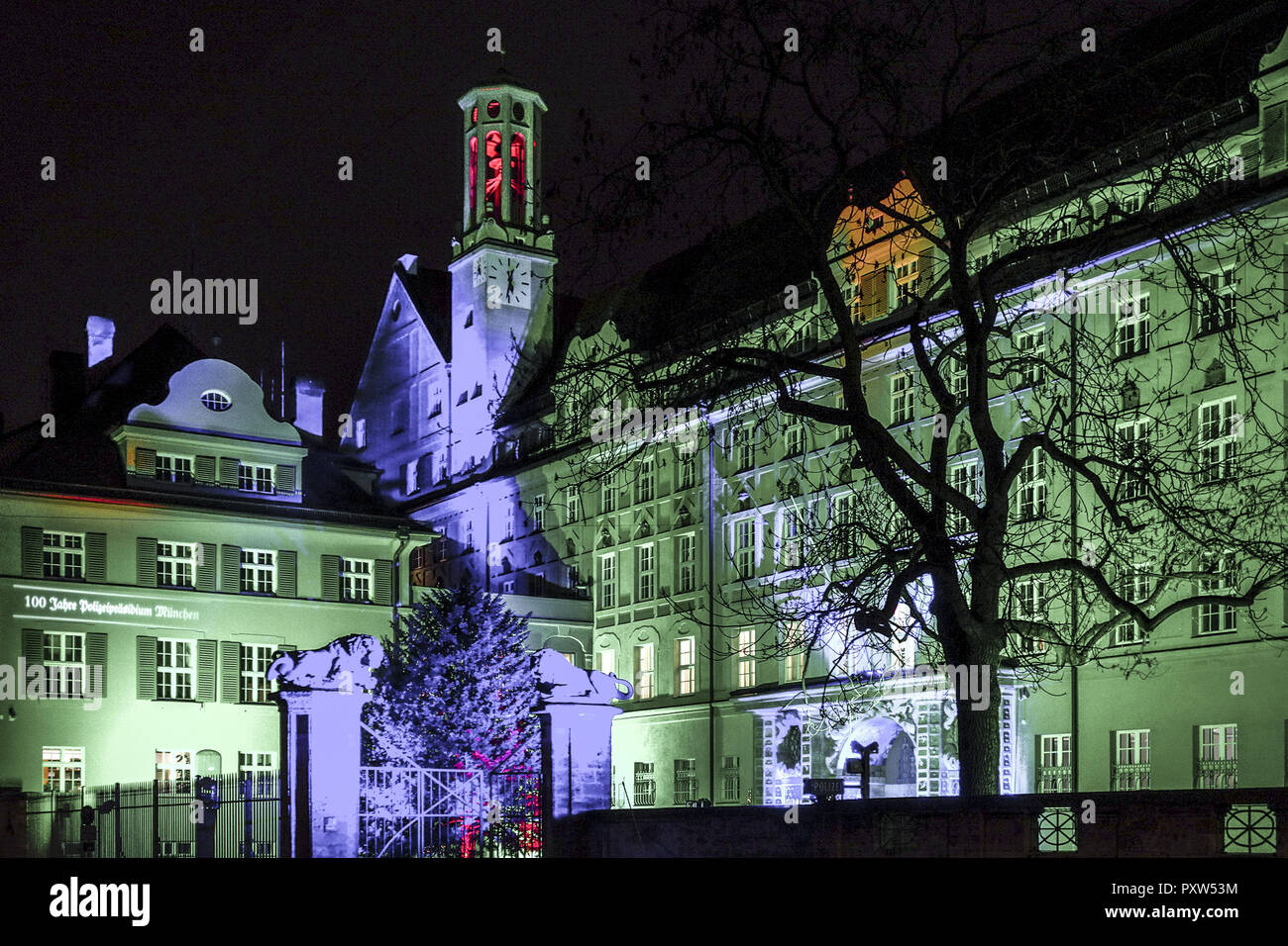 Farbig beleuchtetes Polizeipräsidium in München, Löwengrube, Colored lighted police headquarters in Munich at Night, Germany, Bavaria, Munich, Police, - Stock Image