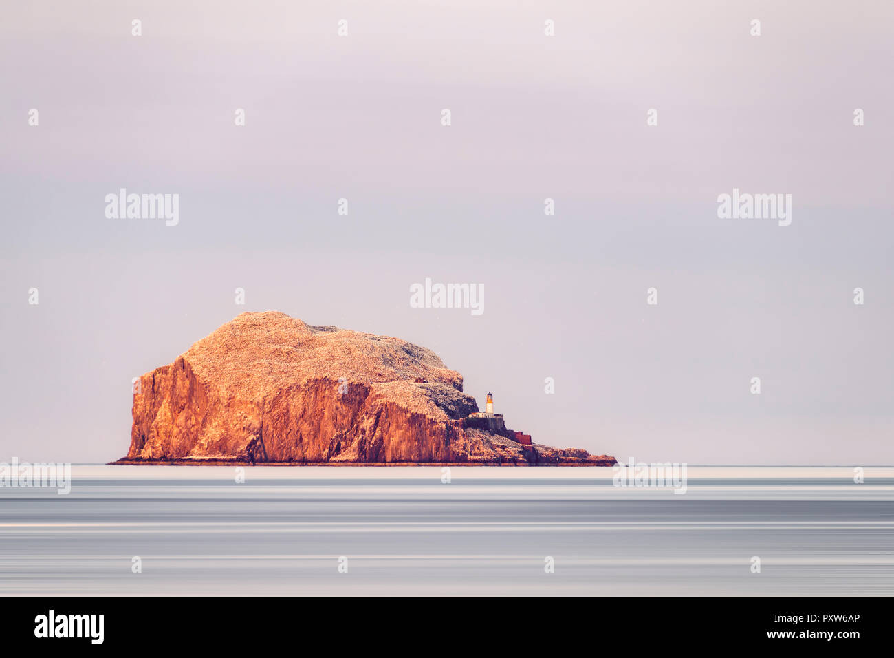 UK, Scotland, East Lothian, North Berwick, Firth of Forth, view of Bass Rock (world famous Gannet Colony), lit by the sunset, Lighthouse, Stock Photo