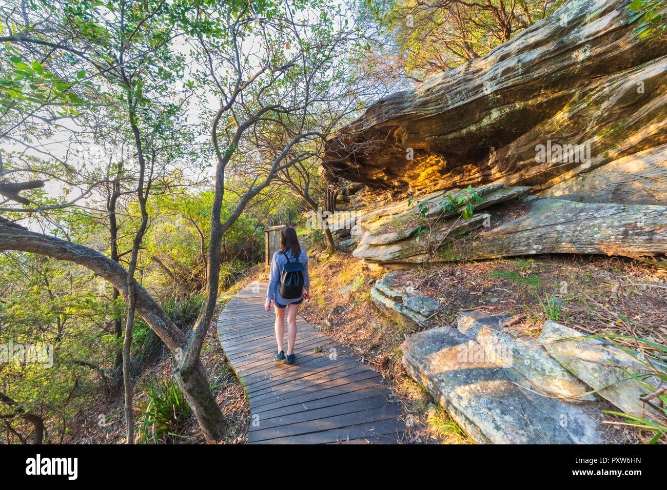 A woman walking along the Hermitage Foreshore Track in  Nielsen Park. Sydney Harbour National Park ,Australia - Stock Image
