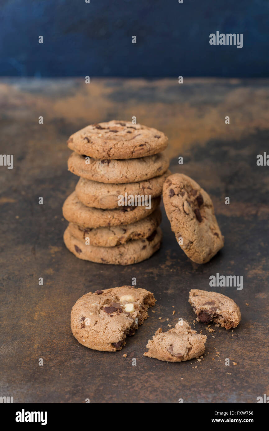 Stack of chocolate cookies on rusty metal - Stock Image