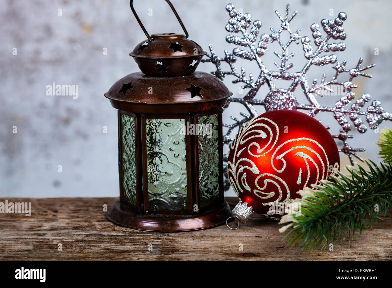 Christmas lantern, fir branch and snowflake on grunge background ...