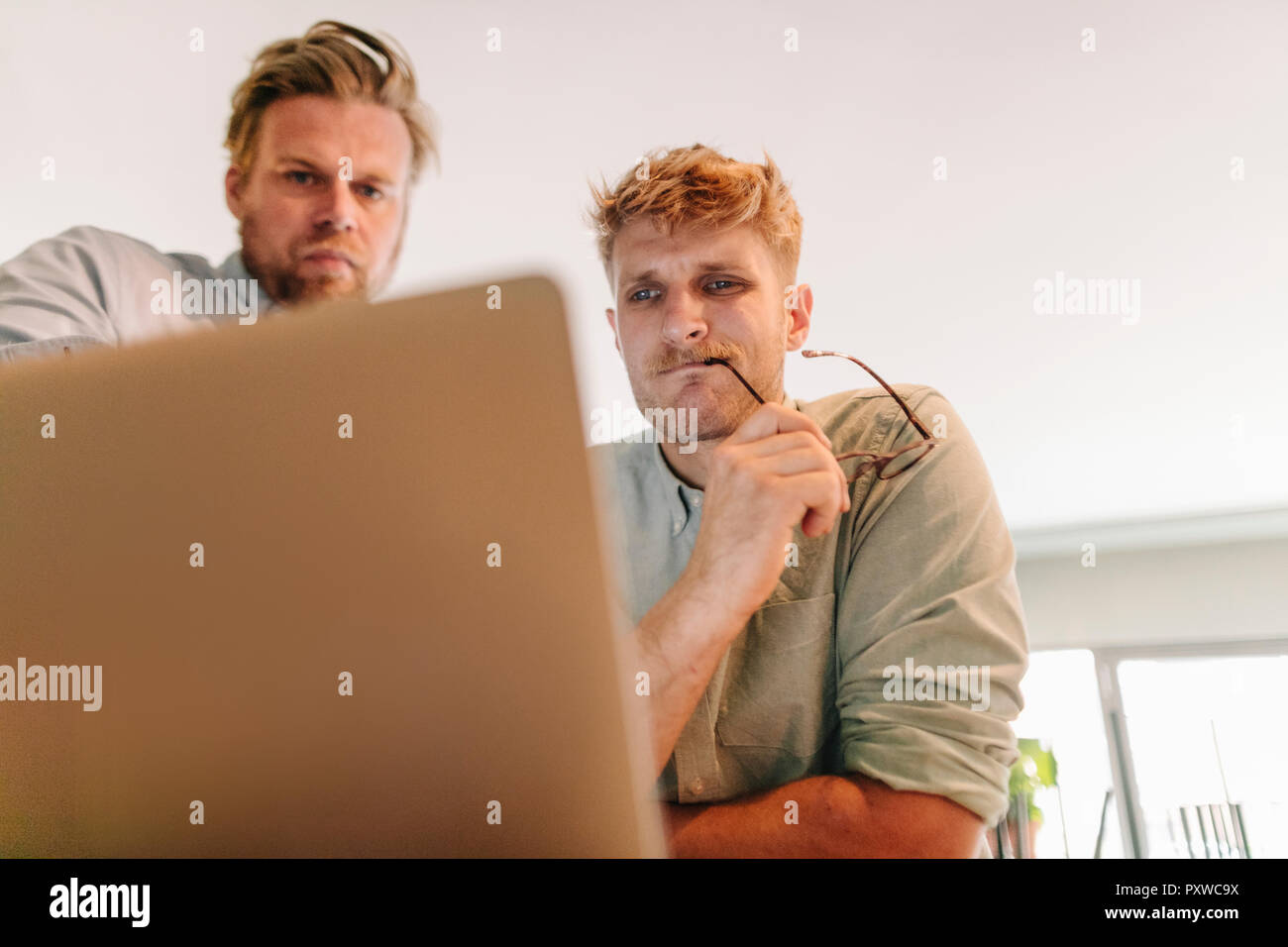 Business partners having a meeting in their new start-up company Stock Photo