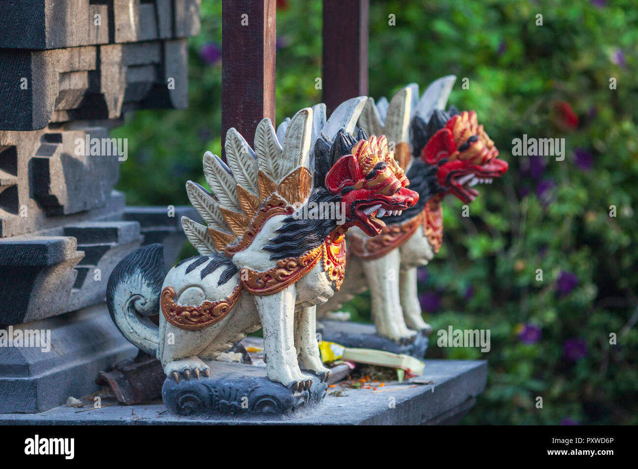 Indonesia, Bali, fierce animal figures at a temple - Stock Image