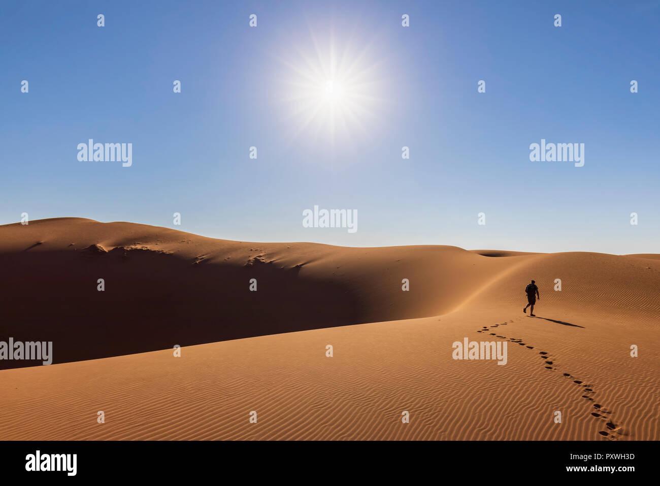 Africa, Namibia, Namib desert, Naukluft National Park, tourist walking on dune - Stock Image