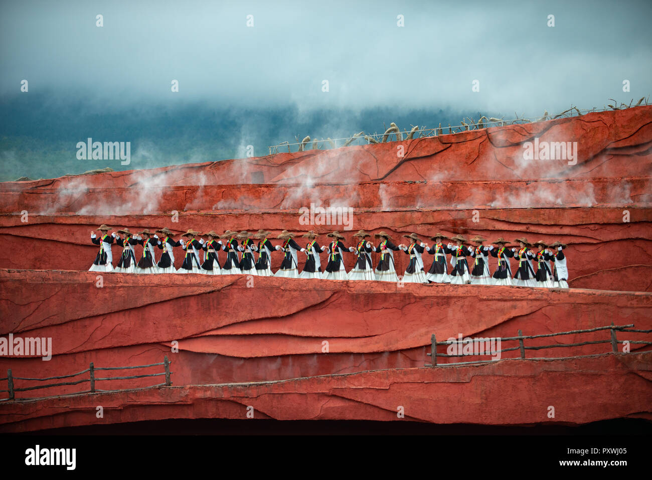 Lijiang Impression stage show held on daily basis with natural Jade Snow Mountain in the background. The show was directed by Zhang Yimou. - Stock Image