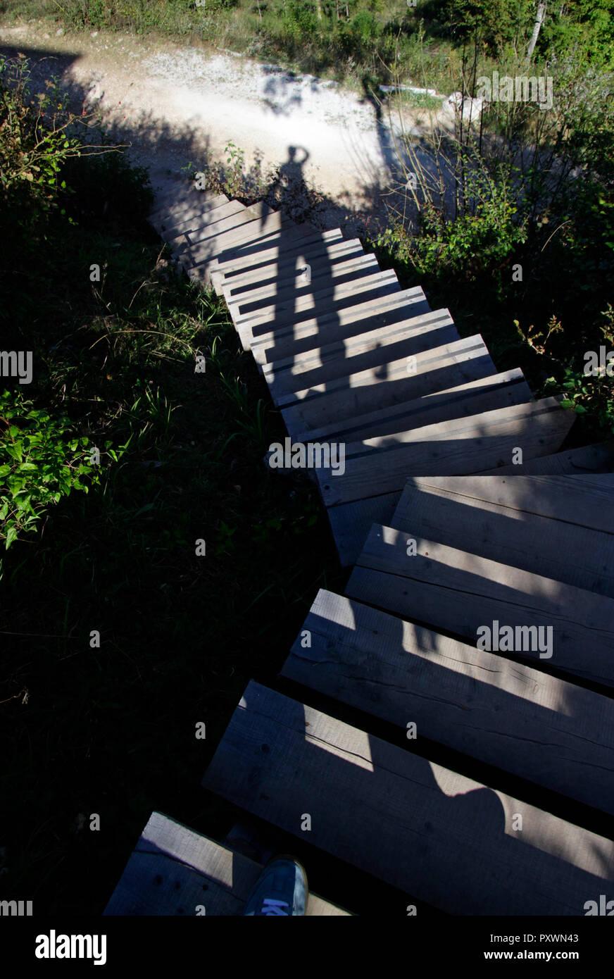 Shadow selfie on stairs - Stock Image
