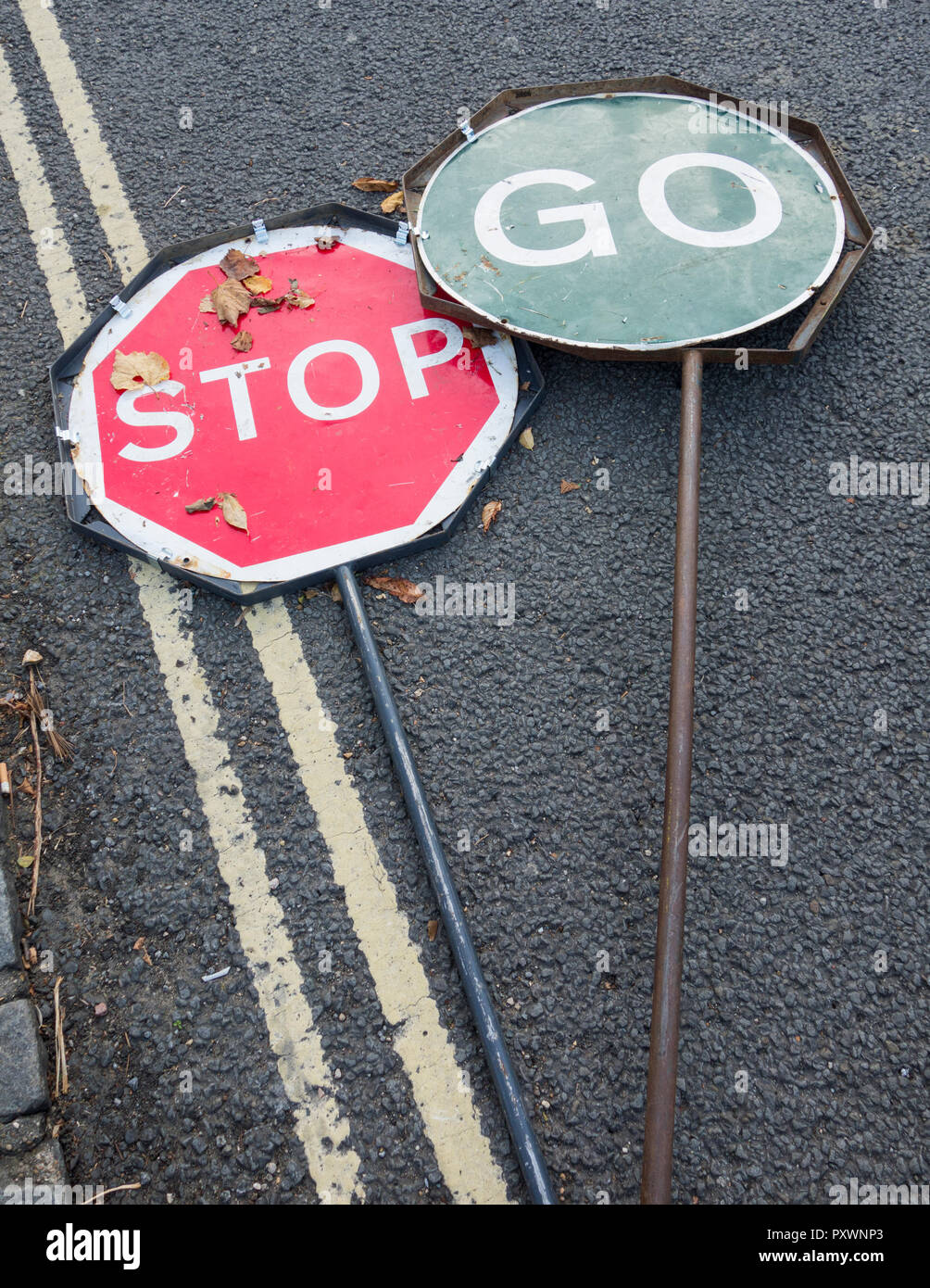 Stop Go traffic indicator signs discarded on a road in the UK - Stock Image
