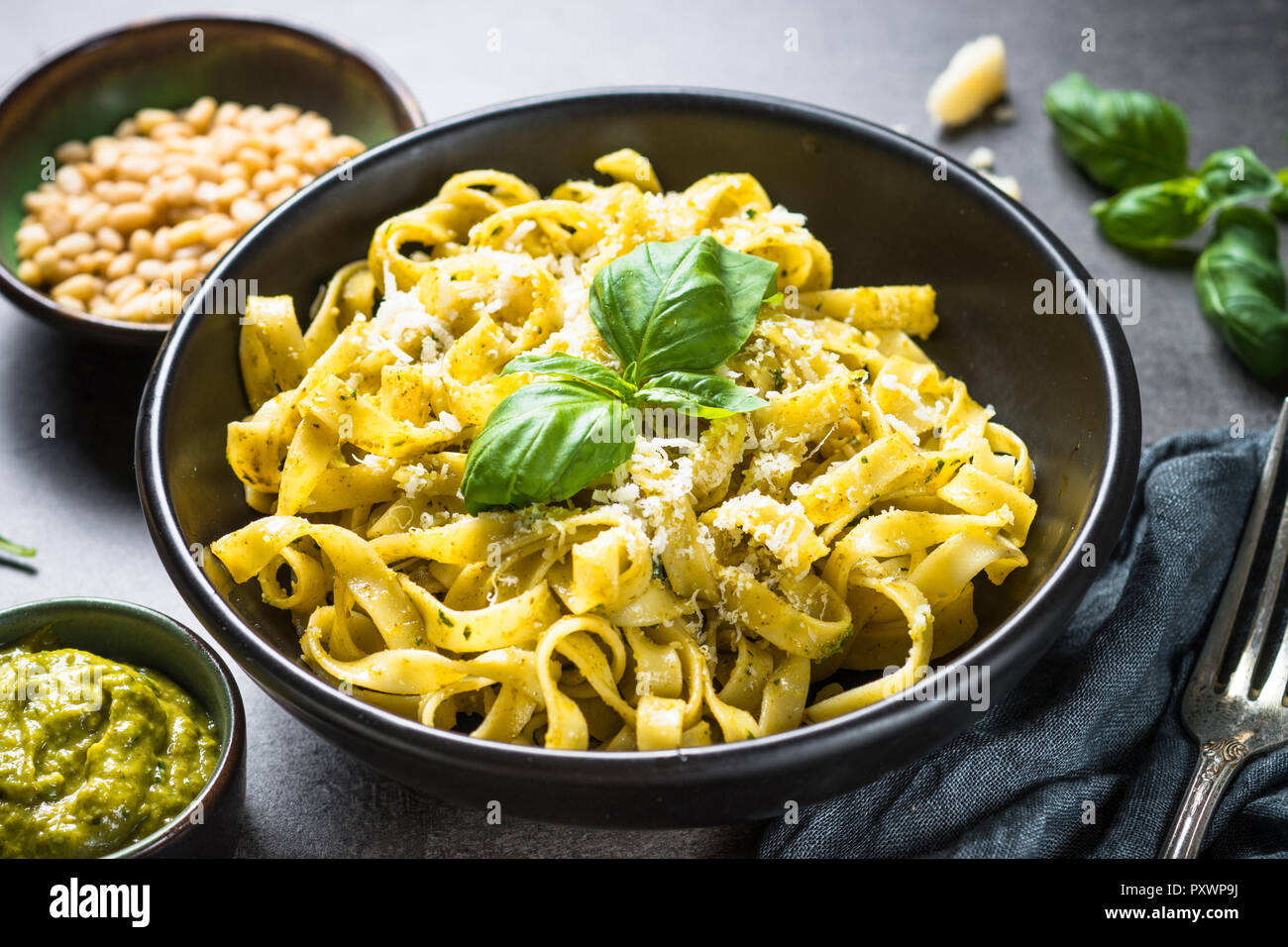 Tagliatelle pasta with pesto sauce and parmesan. - Stock Image