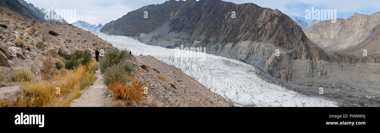 Panoramic autumn view of white Passu glacier surrounded by mountains in karakoram range. Gilgit-Baltistan, Pakistan. - Stock Image