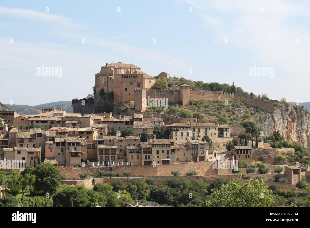 A summer landscape of Alquezar, a small medieval rural town with a castle, a collegiate and a canyon in the Vero river, in Aragon, Spain. Stock Photo