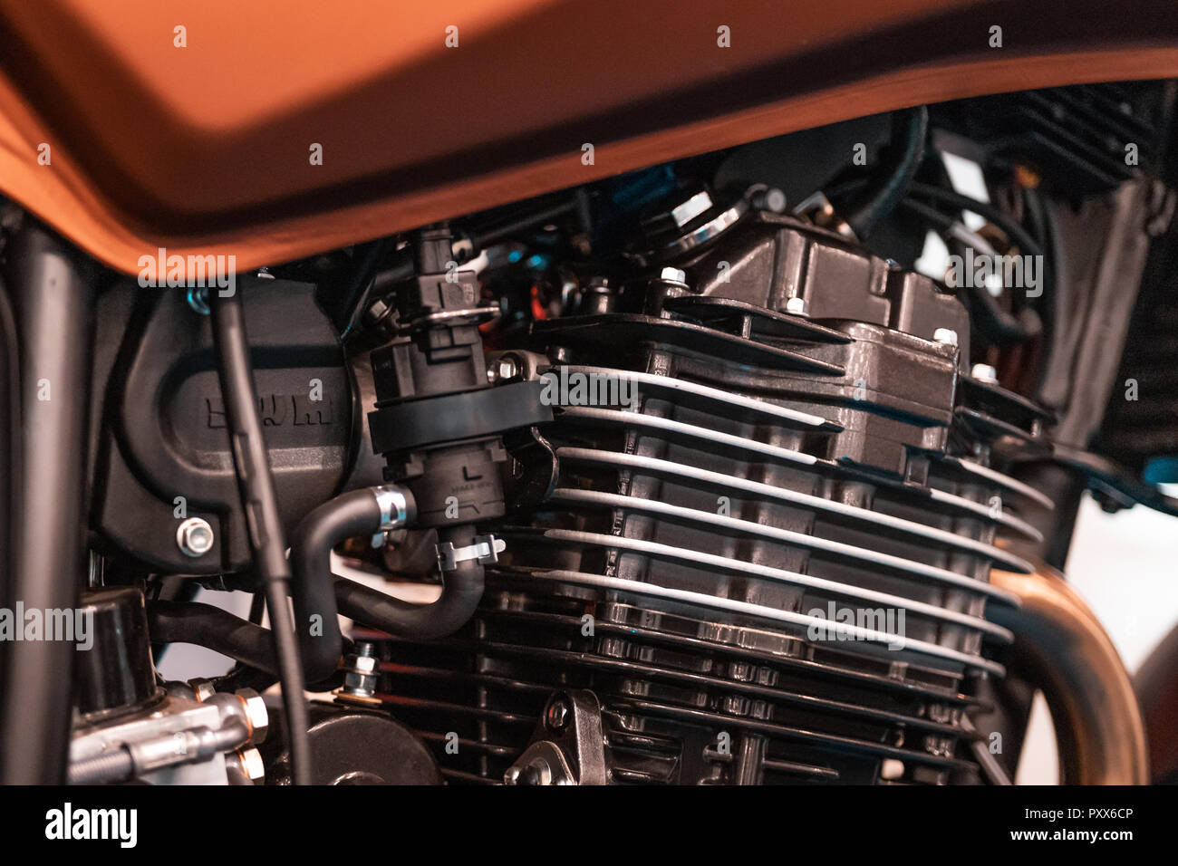 Engine design details, radiator from customized motobike in Italy, Rome. Black parts, chrome pipings. - Stock Image