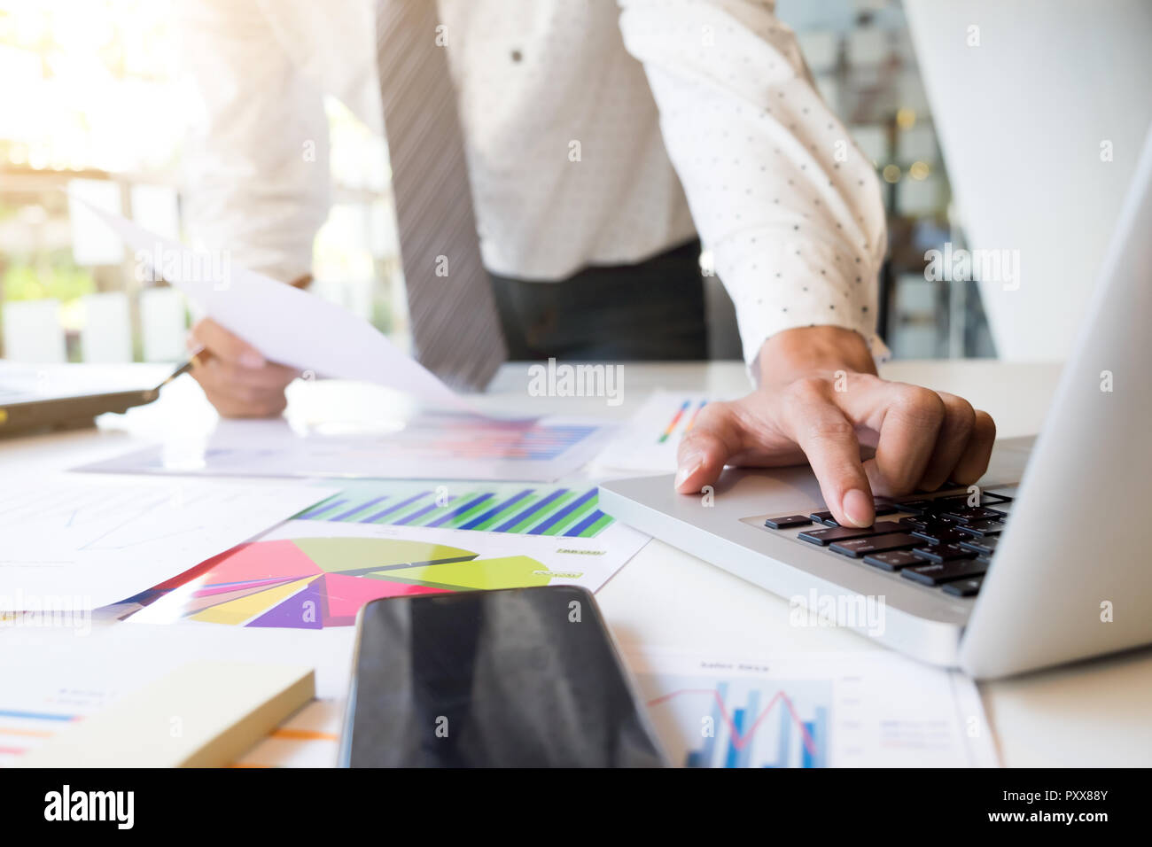 Startup businessman working with business documents on office table with graph financial diagram. Stock Photo