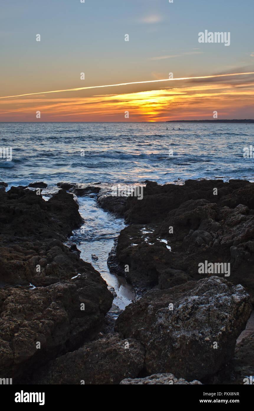 Sunset in Gale Beach, Albufeira. Coast of Algarve, Portugal - Stock Image