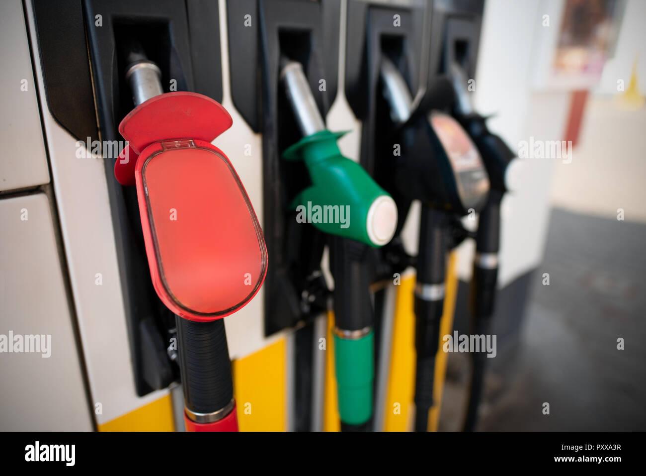 Petrol pump filling nozzles. Fuel at gas station close up Stock Photo