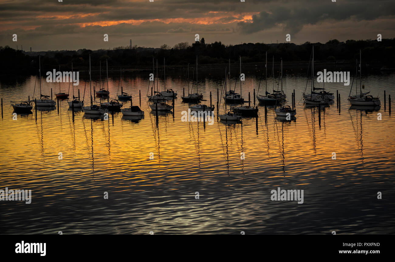 Boats moored in Portsmouth Harbour at sunset - Stock Image