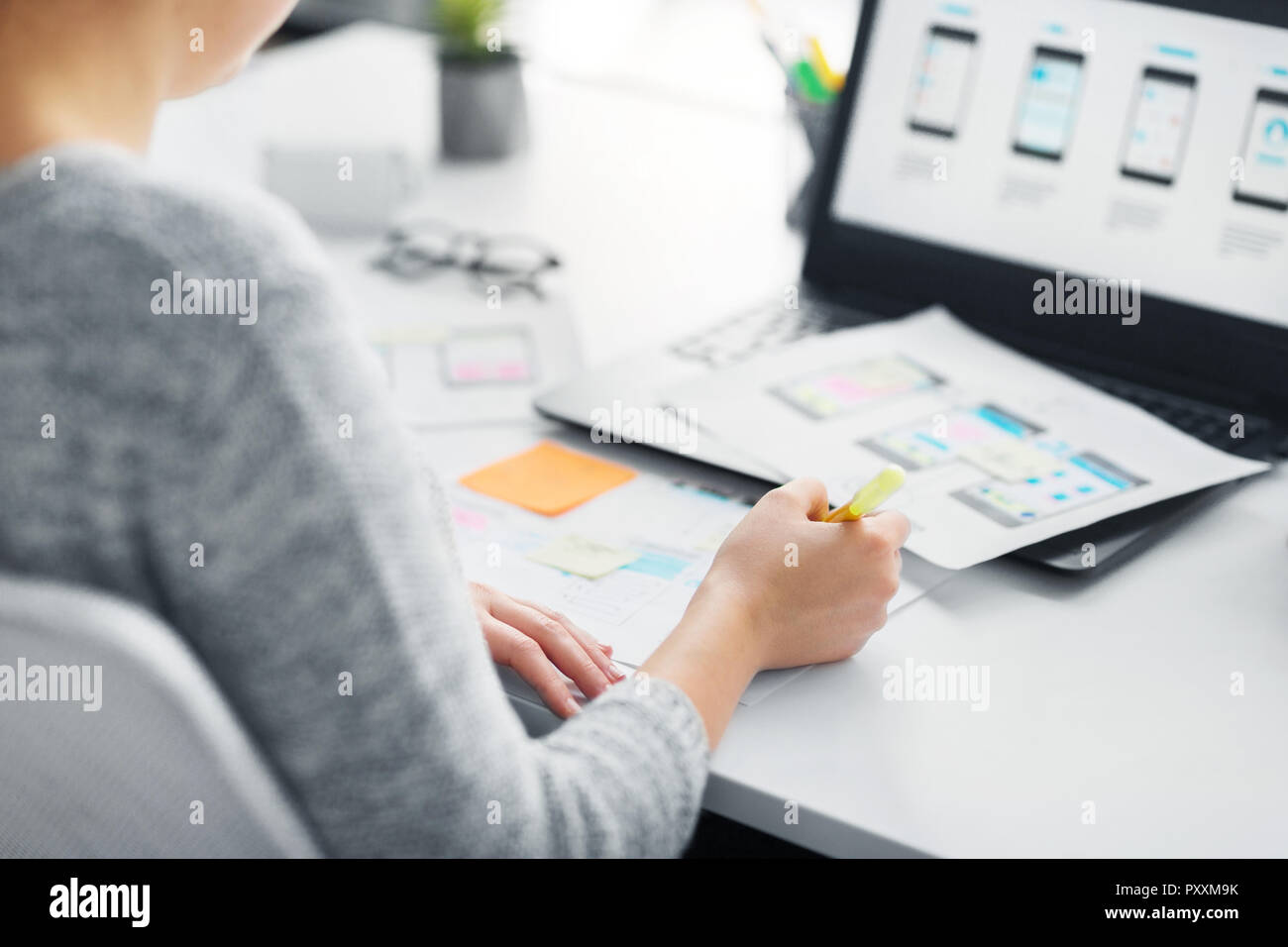 web designer working on user interface at office - Stock Image