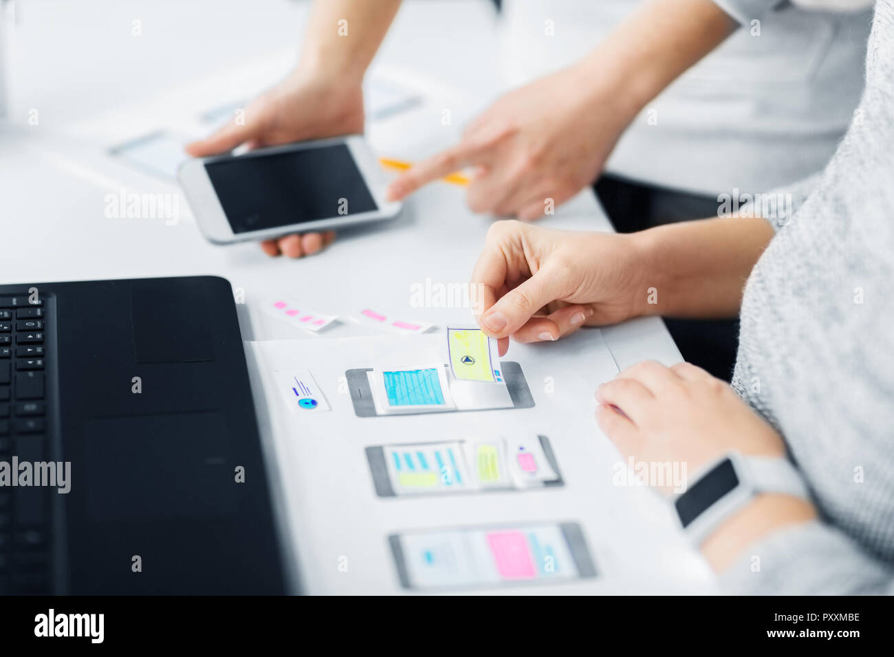 web designers creating mobile user interface - Stock Image