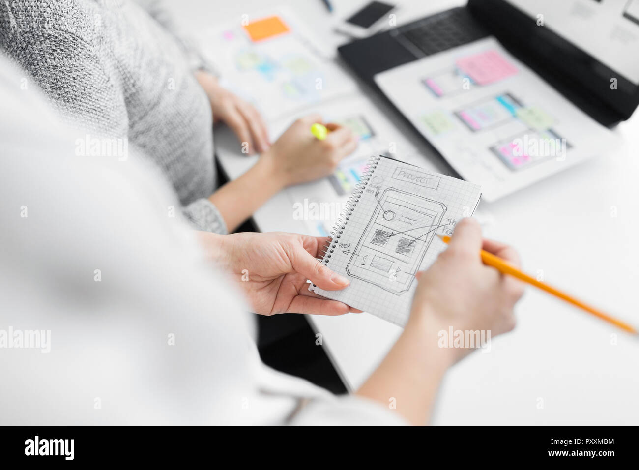 web designers working on user interface project - Stock Image