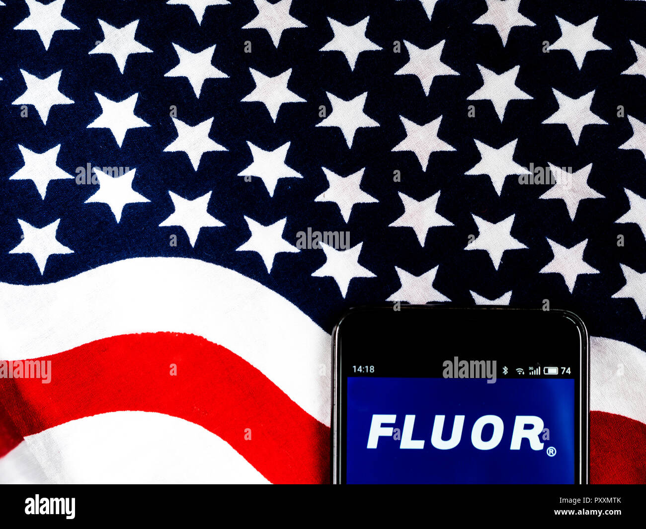 Fluor Corporation Engineering company logo seen displayed on smart