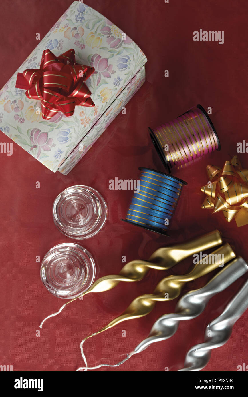 party candles in gold and silver with box and ribbons from above Stock Photo