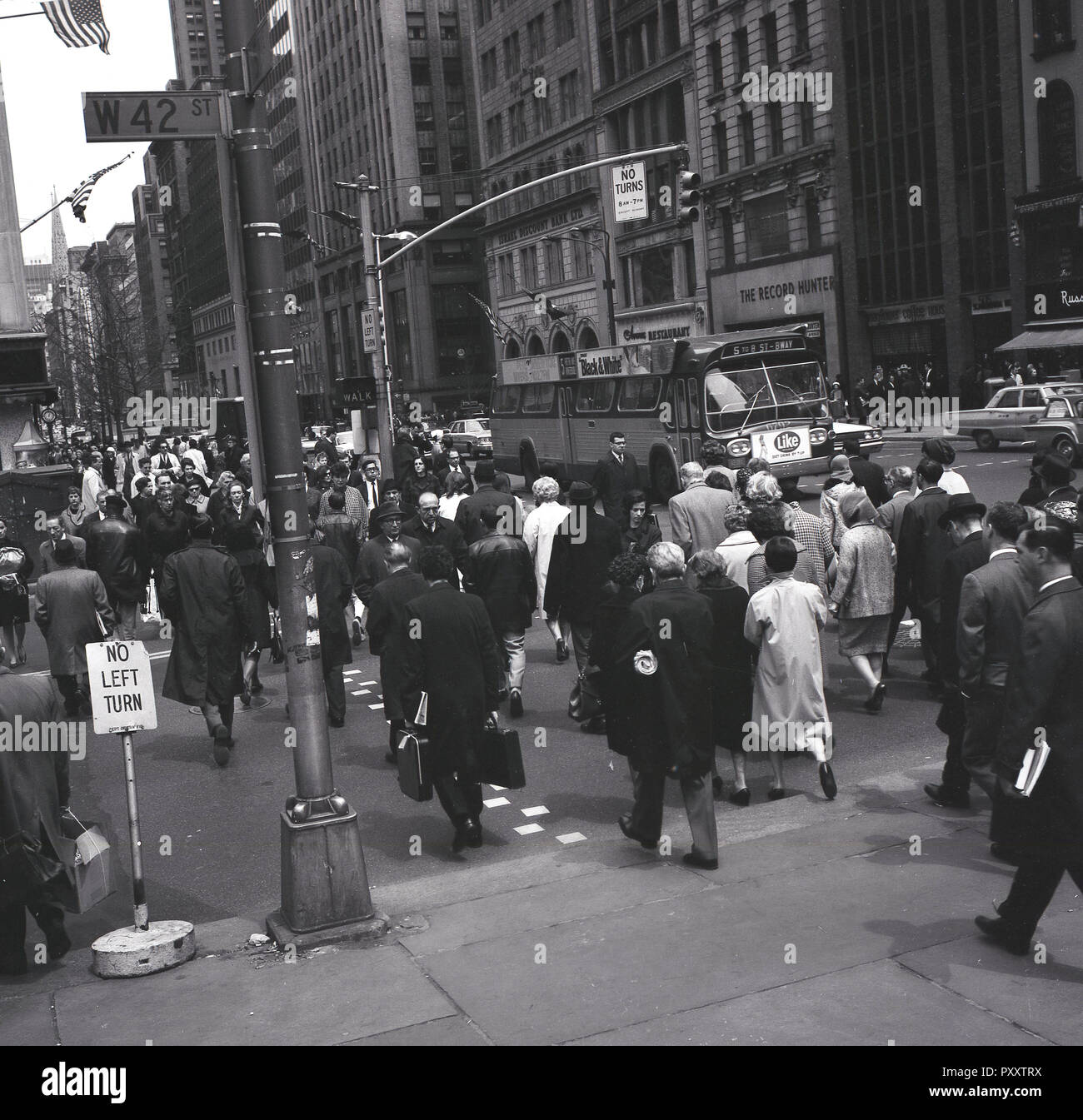 1950s, historical, daytime and New Yorkers at W42 street, a major crosstown street in Manhattan, New York city, USA. - Stock Image