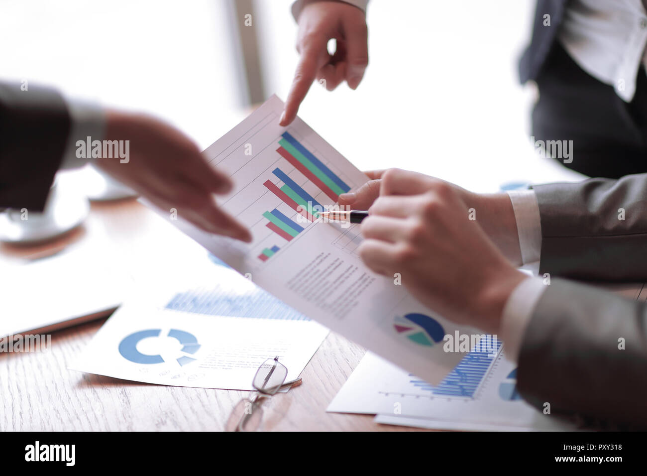 close up.businessman discussing financial data. business concept - Stock Image