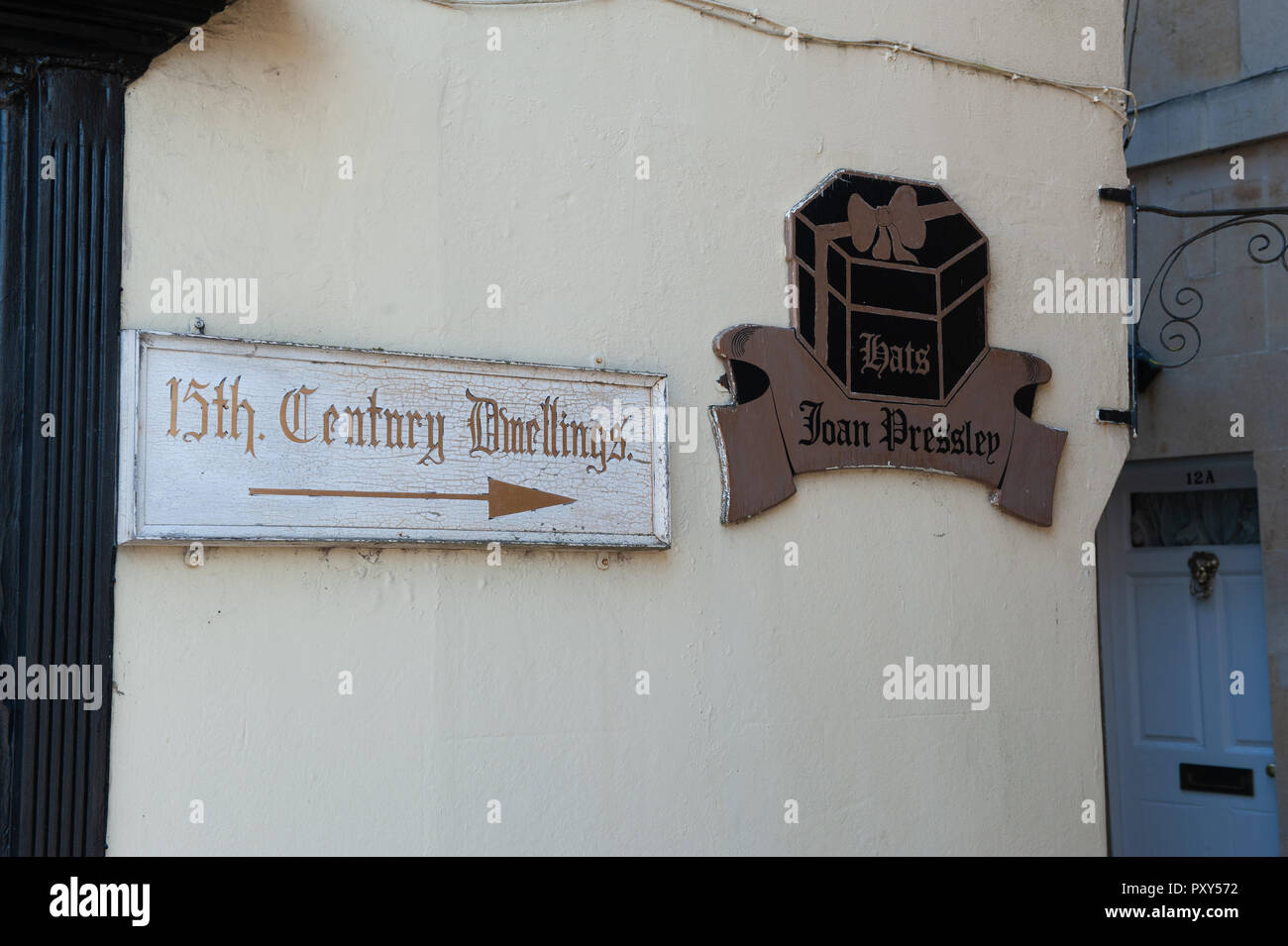 Sign for 15th Century buildings in St John's Alley, Devizes, Wiltshire, UK. - Stock Image