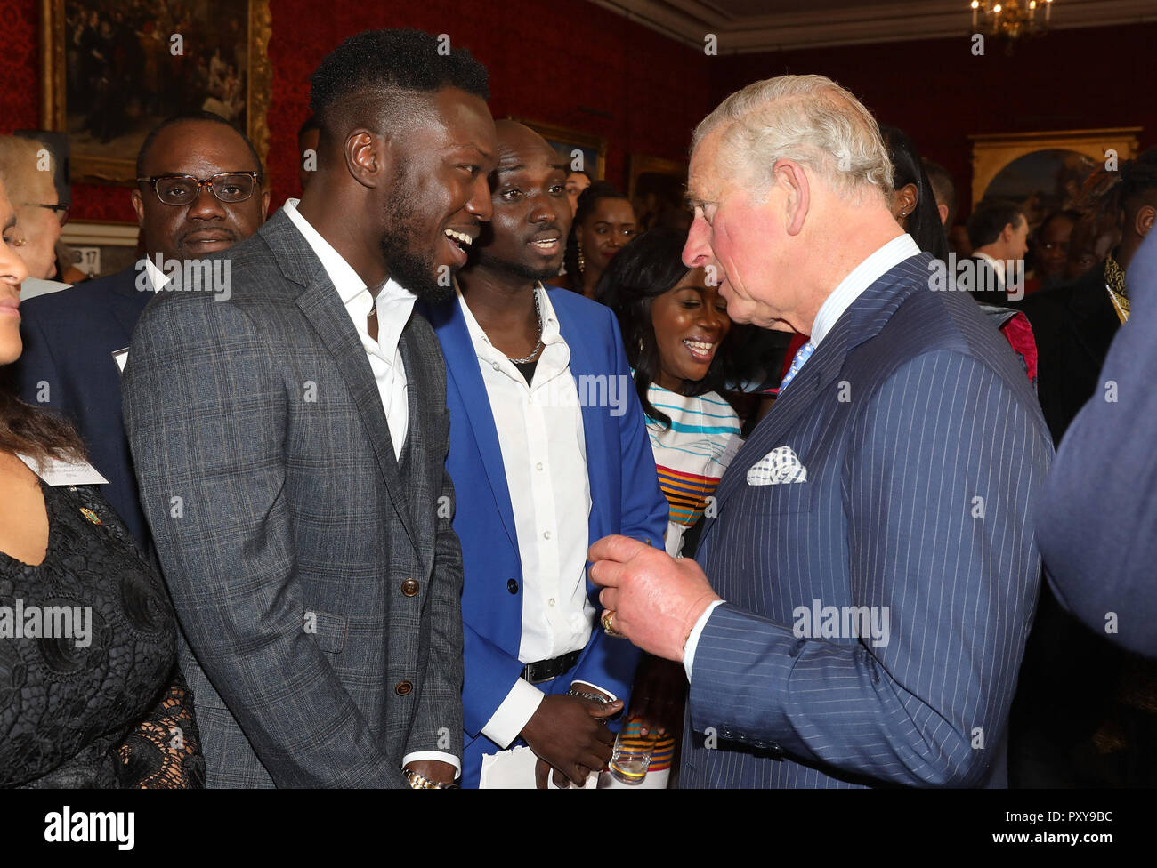The Prince of Wales talking with Ghanian Music duo Reggie Zippy and Bollie Babeface known as 'Reggie 'n' Bollie' during a reception at St James's Palace, London, ahead of his visit to The Gambia, Ghana and Nigeria. Stock Photo