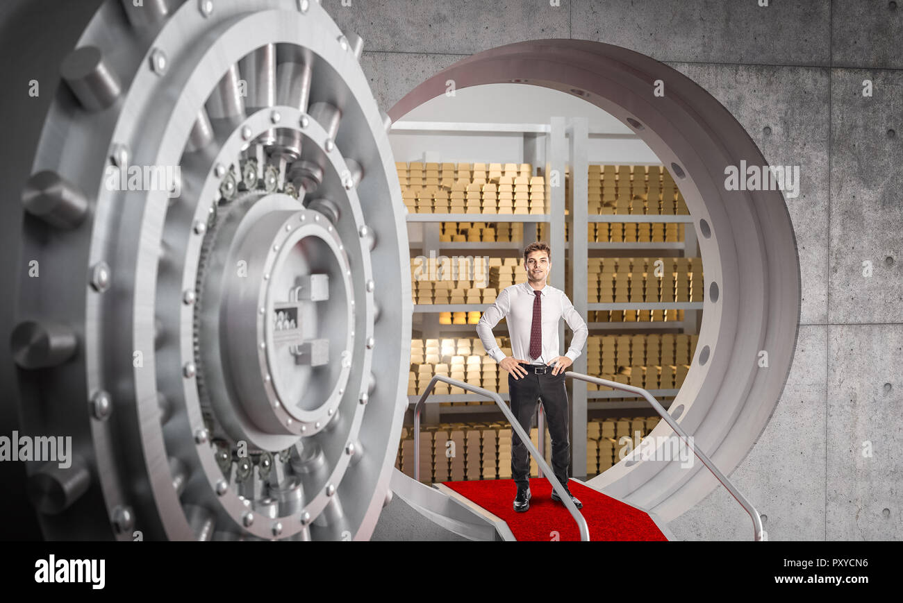 businessman and huge bank vault background - Stock Image