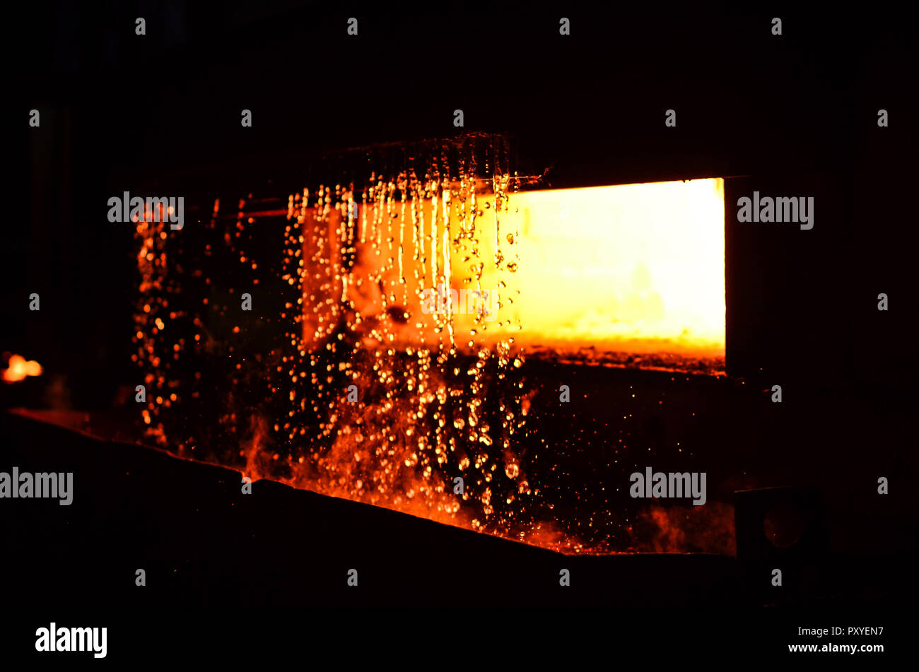High temperature in the melting furnace. Metallurgical industry. Heavy forging steelmaking plant and steelmaking workshop. Oven. Water curtain. - Stock Image