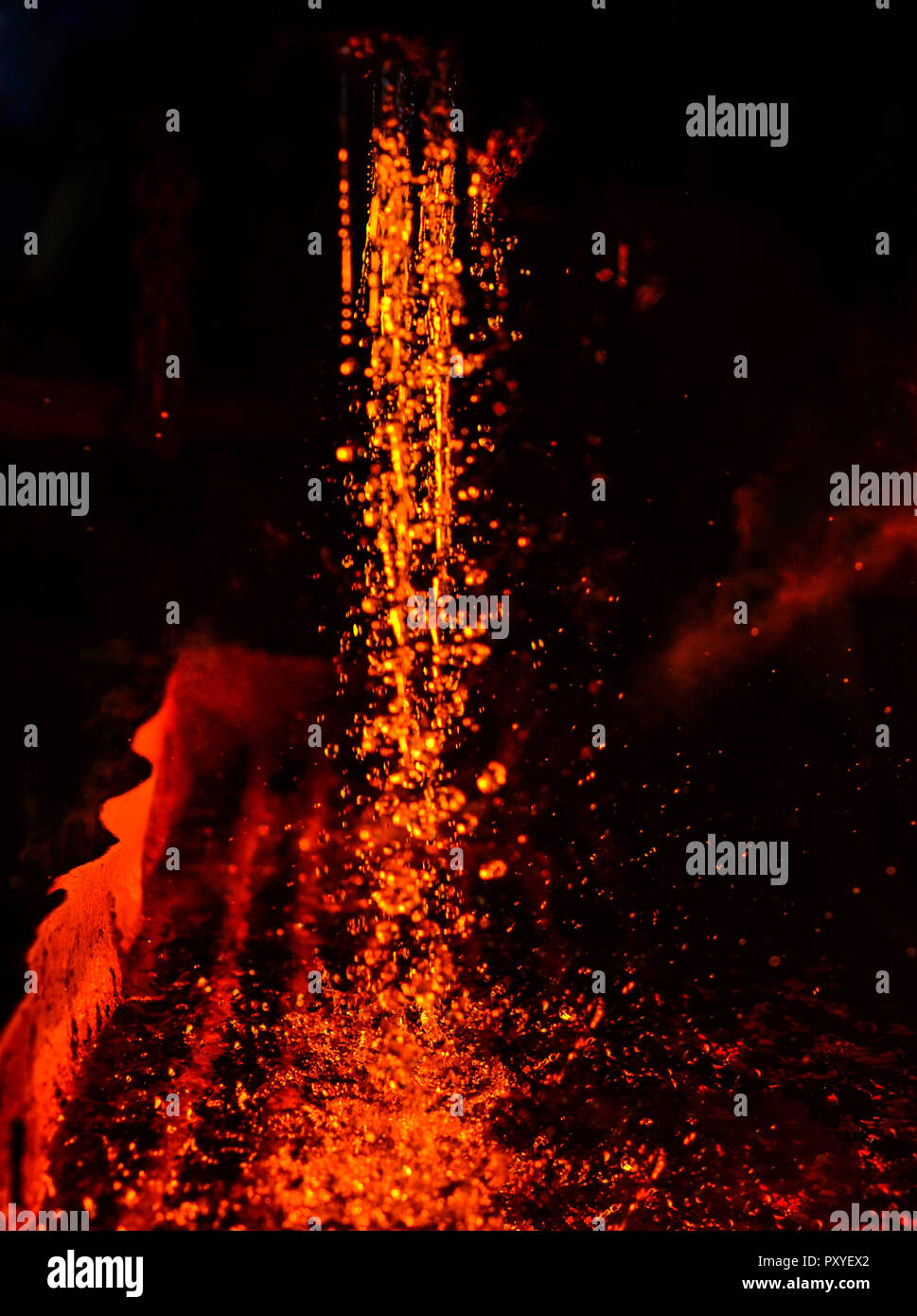 Metal on casting. Metallurgy.  High temperature in the melting furnace. Heavy forging steelmaking plant and steelmaking workshop. Oven. Water curtain. Stock Photo