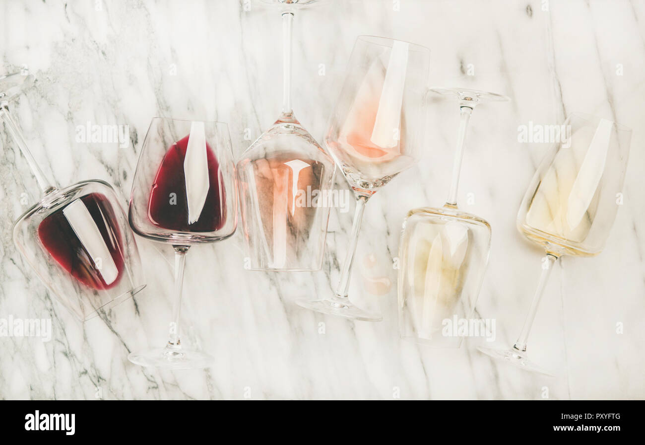 Red, rose, white wine in glasses and corkscrews - Stock Image