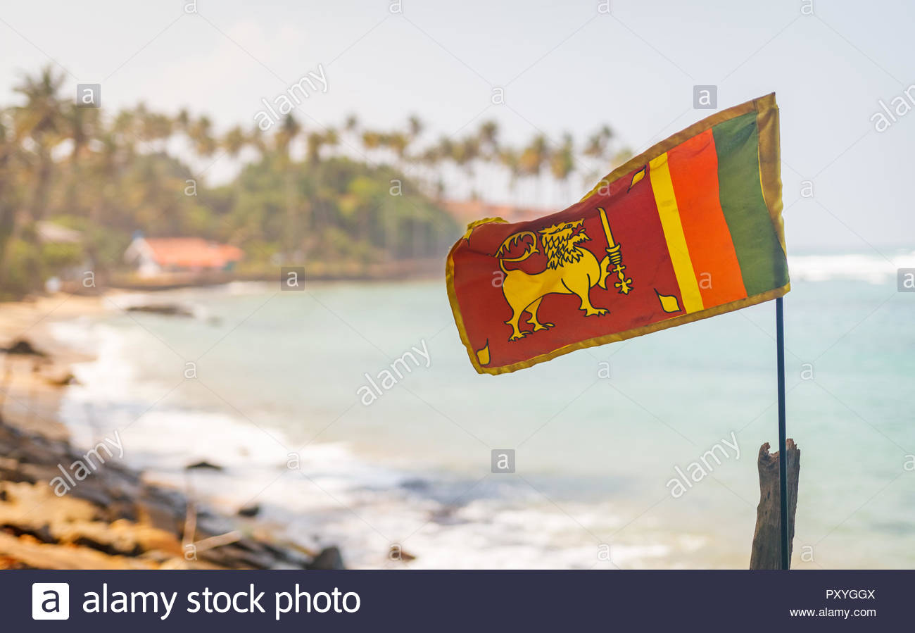 Sri Lanka flag in the Mirissa beach on the background - Stock Image